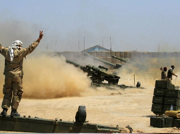 Iraqi security forces and allied Popular Mobilization forces fire artillery during fight against Islamic State militants in Fallujah, Iraq