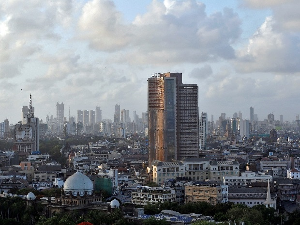 Clouds are seen over the Bombay Stock Exchange (BSE) building in Mumbai