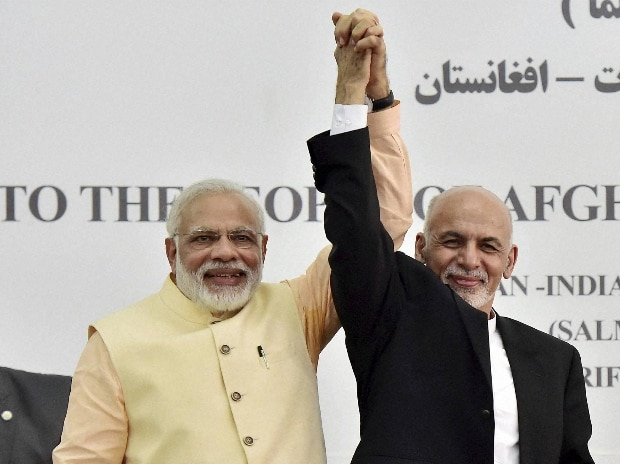 Prime Minister Narendra Modi and Afghan President Ashraf Ghani raise each other's hands after inaugurating Afghan-India Friendship Dam in Herat, Afghanistan. PTI Photo by Kamal Kishore