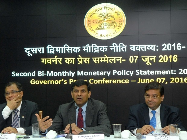 RBI Governor Raghuram Rajan with deputy governors (L to R) S S Mundra, H R Khan and Urjit Patel during a press conference to announce the second bi-monthly press conference to announce the second bi-monthly