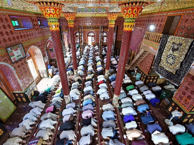 People offering prayers on the 1st Friday of holy Month of Ramadan, at Dastgeer Sahib shrine in Srinagar