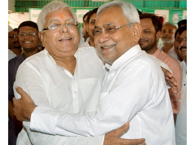 Bihar Chief Minister Nitish Kumar greets RJD chief Lalu Prasad on latter's 69th birthday