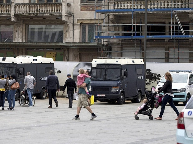 People walk past police vans outside Antwerp Central train station in Antwerp, Belgium on Saturday, June 18, 2016. Police and the bomb squad unit responded to a suspect package in the Antwerp station. (AP/PTI)