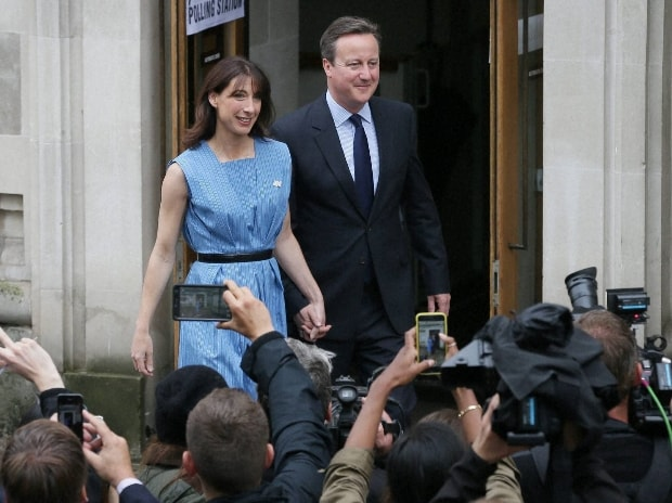 David Cameron and his wife Samantha leave