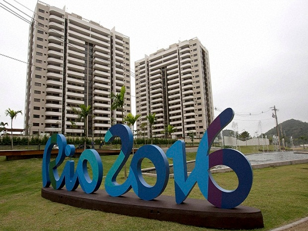 The Rio 2016 sign stands in front of the Olympic Village during a media tour in Rio de Janeiro, Brazil. Photo: AP/PTI
