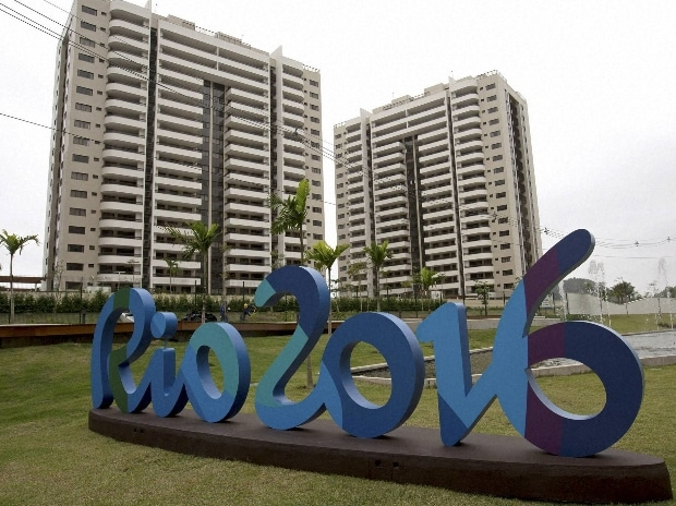 The Rio 2016 sign stands in front of the Olympic Village in Rio de Janeiro