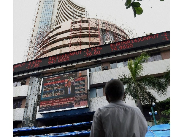 Stock broker looking at screen outside the Bombay Stock Exchange