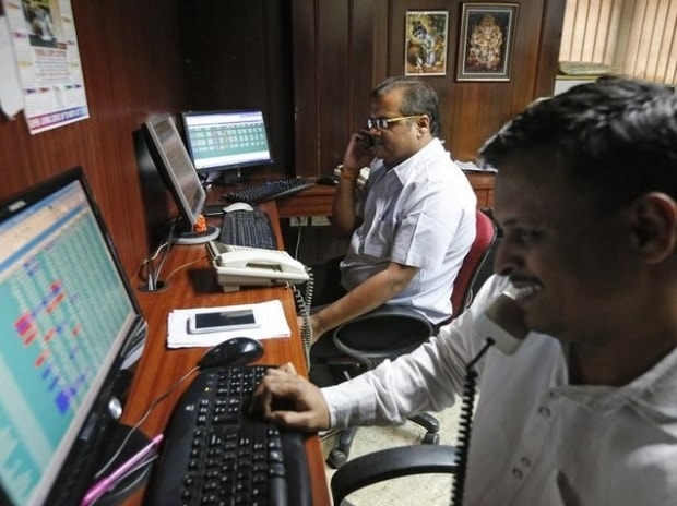 Brokers trade at their computer terminals at a stock brokerage firm in Mumbai (