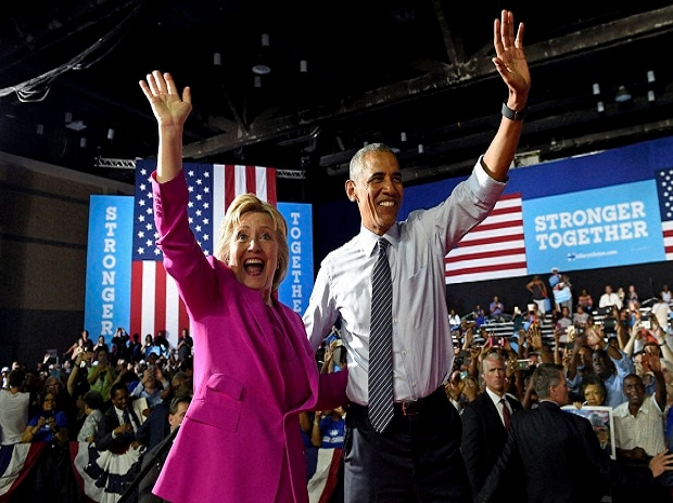 President Barack Obama and Democratic presidential candidate Hillary Clinton wave following a campaign event at the Charlotte Convention Centre in Charlotte, NC.