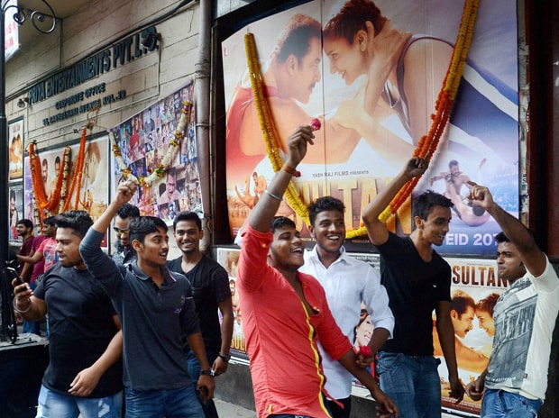 Fans of actor Salman Khan dance during the release of the actor's new movie