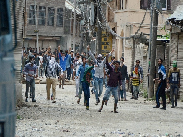 Protesters throwing stones on police vehicle during a protest following the killing of Hizbul Mujahideen commander Burhan Muzaffar Wani along with his two associates, in Srinagar on Saturday   Photo: PTI