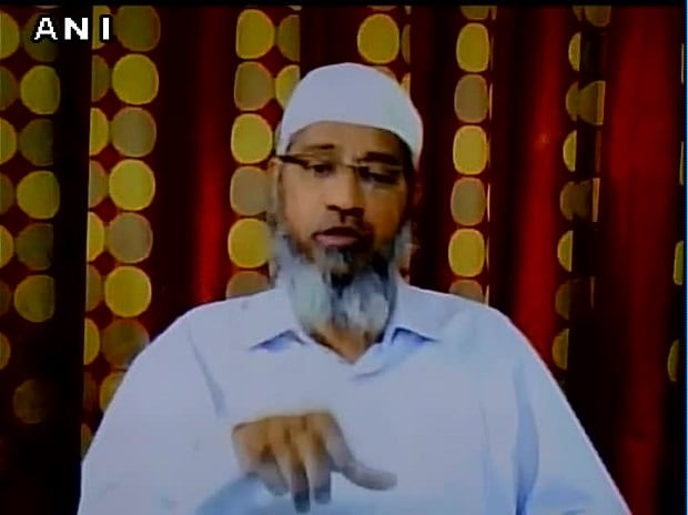 Zakir naik talking to journalists via Skype from Medina. (Photo: ANI's twitter handle)