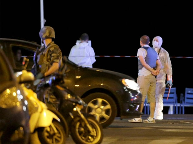 Forensic officers at the scene of an attack after a truck drove on to the sidewalk and plowed through a crowd of revelers who'd gathered to watch the fireworks in the French resort city of Nice, southern France. Photo: PTI