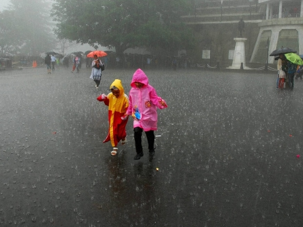 Children enjoy monsoon rains