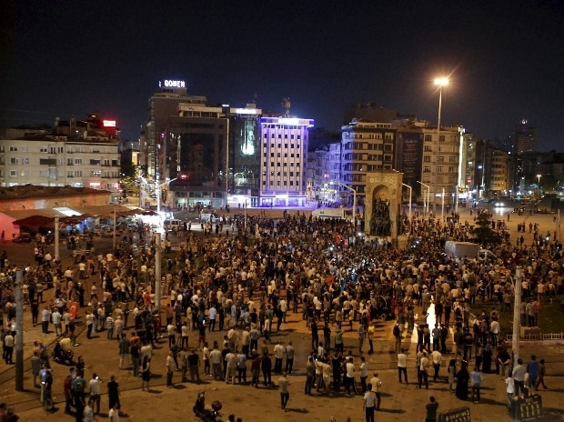 Supporters of Turkey's President Recep Tayyip Erdogan, gather in Istanbul's Taksim square, early morning