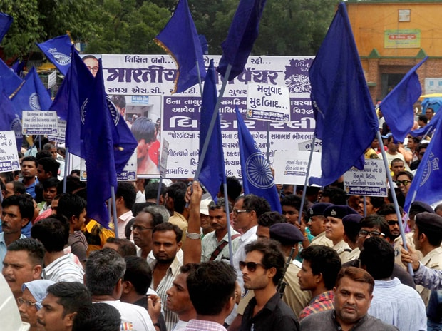 Members of Dalit Community protest in Ahmedabad on Tuesday against the assault on dalit members by cow protectors in Rajkot district. Photo: PTI