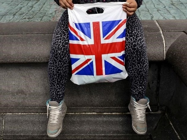 A woman holds a Union Flag shopping bag in London  Reuters