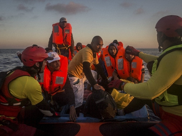 Refugees and migrants overcrowd a wood boat as they are rescued by a team of the Spanish NGO Proactiva Open Arms during a rescue operation on the Mediterranean sea