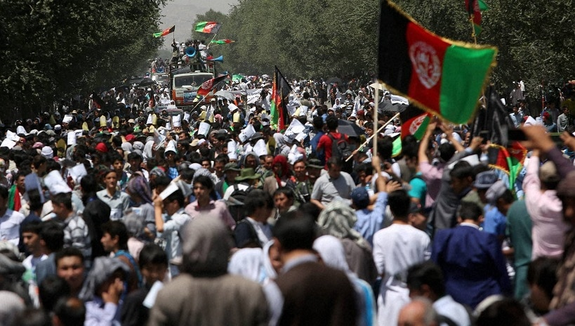 Thousands of demonstrators march towards the center of Kabul, Afghanistan, on Saturday Photo: PTI