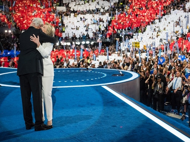 Former US President Bill Clinton hugs his wife, Hillary Clinton after the latter accepted Democratic Presidential nomination for the US elections 2016 at the Democratic National Convention in Philadelphia. Photo: Hillary Clinton Twitter Handle