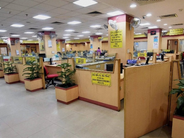 A deserted bank during the public sector bank employees go on strike in New Delhi on Friday to protest against the proposed merger of associate banks with SBI and banking reforms announced by the government