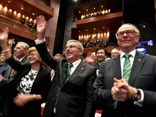 International Olympic Committee President Thomas Bach, second right, and President of the Rio 2016 Olympic Organizing Committee Carlos Arthur Nuzman, right