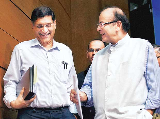 Finance Minister Arun Jaitley (right) and Chief Economic Advisor Arvind Subramanian share a light moment after a press briefing in New Delhi on Thursday