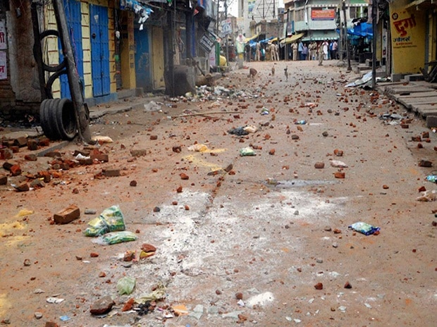Brick pices spread on the road after clashes between two communities in Chhapra, Saran district of Bihar.