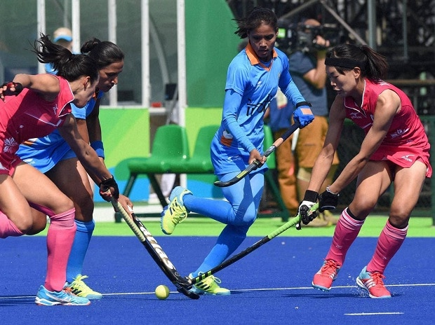 Indian and Japanese women hockey players vie for the ball during opening match of pool B at the Rio Olympic 2016 in Rio de Janeiro, Brazil on Sunday (PTI Photo)