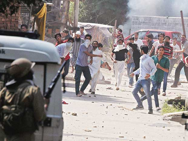 A file photo of protesters pelting stones at security personnel in Srinagar