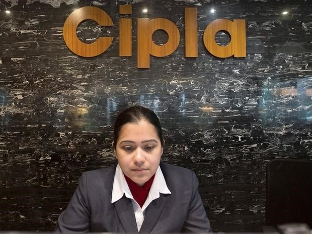 An employee works at the reception area of Cipla at its headquarters in Mumbai