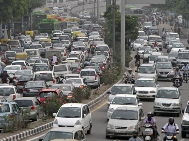 Heavy traffic moves along a busy road during a power-cut at the traffic light junctions in New Delhi