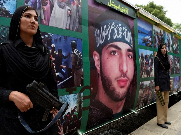 Female Pakistani police officers stand guard outside a train decorated with pictures of slain Hizbul Mujahideen militant Burhan Wani for the upcoming Independence Day in Islamabad, Pakistan.