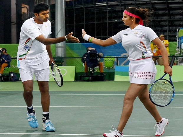 Sania Mirza and Rohan Bopanna exchange hifi during their match against S Stosur and J Peers of Australia during the 2016 Summer Olympics at Rio de Janeiro in Brazil.