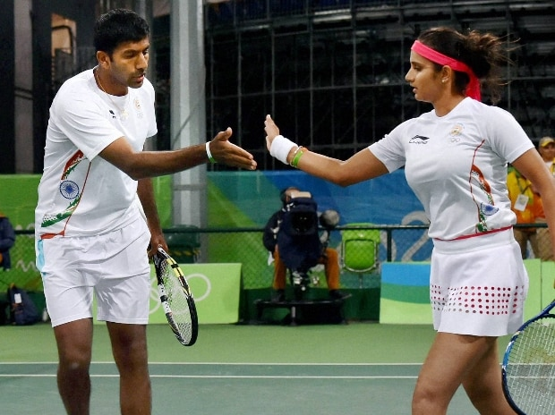 Sania Mirza and Rohan Bopanna exchange hifi during their match  against  S. Stosur and J. Peers of Australia during the 2016 Summer Olympics at Rio de Janeiro in Brazil