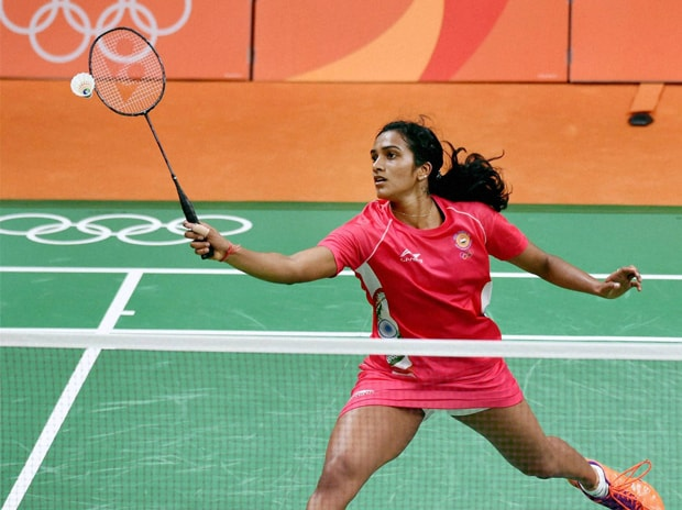 Shuttler PV Sindhu plays a shot in the  pre-quarter Finals match against Tai Tzu Ying of  Chinese Taipei. Photo: PTI