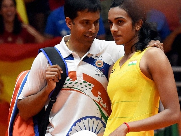 India's Pusarla V Sindhu with coach Pullela Gopichand after she lost against Spain's Carolina Marin in women's Singles final at the 2016 Summer Olympics at Rio de Janeiro in Brazil