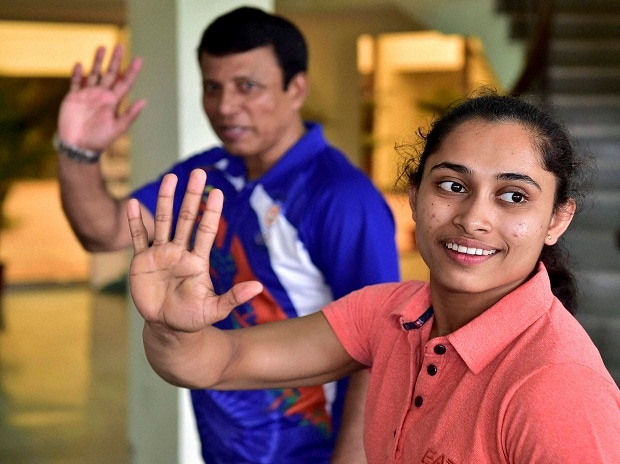 Dipa Karmakar (R), who missed out on an Olympic medal by 0.150 points in Vaults final, with coach Bishweshwar Nandi at IG Stadium in New Delhi