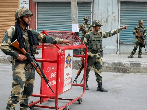 BSF Jawans guard the streets during Curfew in Srinagar
