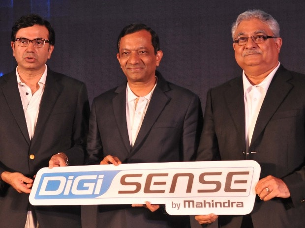 (From left to right) Rajesh Jejurikar, head, farm equipment and two-wheeler business, Mahindra Group, Pawan Goenka, Executive Director, Mahindra & Mahindra and Rajan Wadhera, President and Chief Executive - Truck, Power Train Division and Head - MRV,