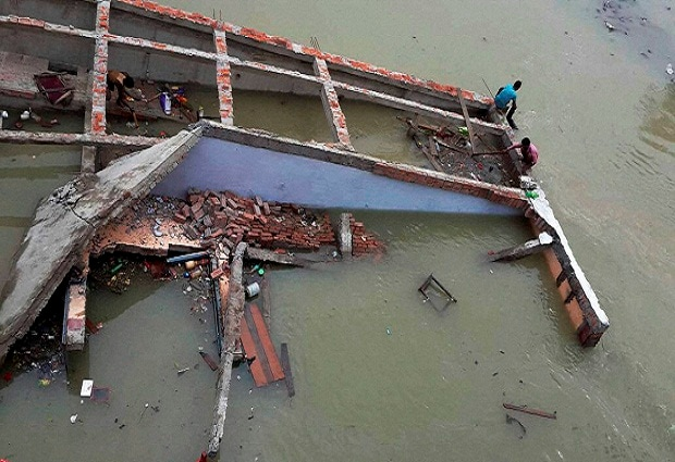 A building collapses in flood water at Chapra in Saran district of Bihar.