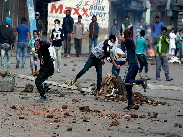 Protesters throwing stones on security forces during a clash in Srinagar