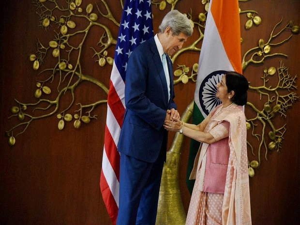 Foreign Minister Sushma Swaraj  shakes hands with US Secretary of State John Kerry during  a meeting in New Delhi