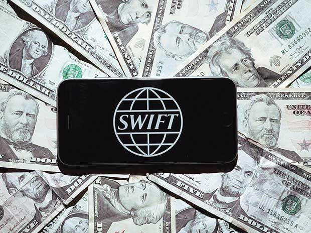 SWIFT discloses cyber thefts, pressures banks on security | Business Standard News