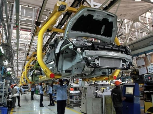Workers assemble Ford cars at a plant of Ford India in Chengalpattu on the outskirts of Chennai