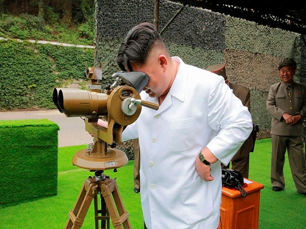 This undated photo distributed on Sept 6, 2016, by the North Korean govt shows North Korean leader Kim Jong-un looking though binoculars at the site of a ballistic missile launching at an undisclosed location in North Korea.