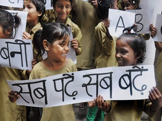 Children celebrate International Literacy Day by holding placards at a school in Moradabad
