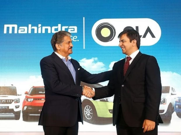 Anand Mahindra (L), chairman and managing director of Mahindra Group, and Bhavish Aggarwal, CEO and co-founder of Ola