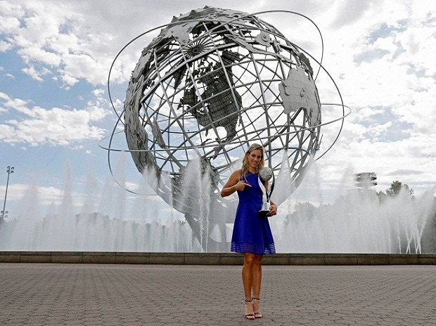 Angelique Kerber of Germany poses with the WTA No. 1 trophy. File Photo