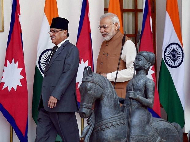 Prime Minister Narendra Modi along with his Nepalese counterpart Pushpa Kamal Dahal arrive for a meeting at Hyderabad House in New Delhi